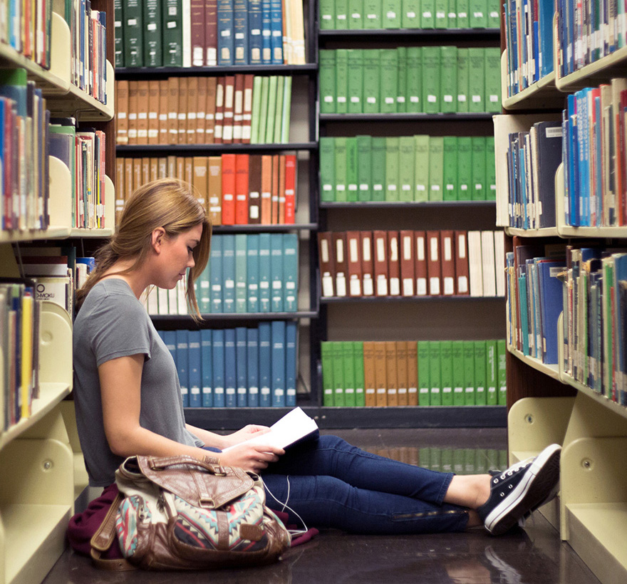 Female student reading in the CSULB library
