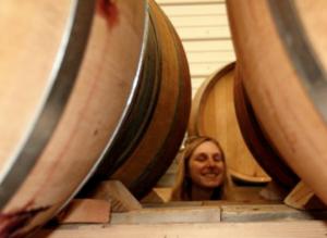 woman in wine cellar
