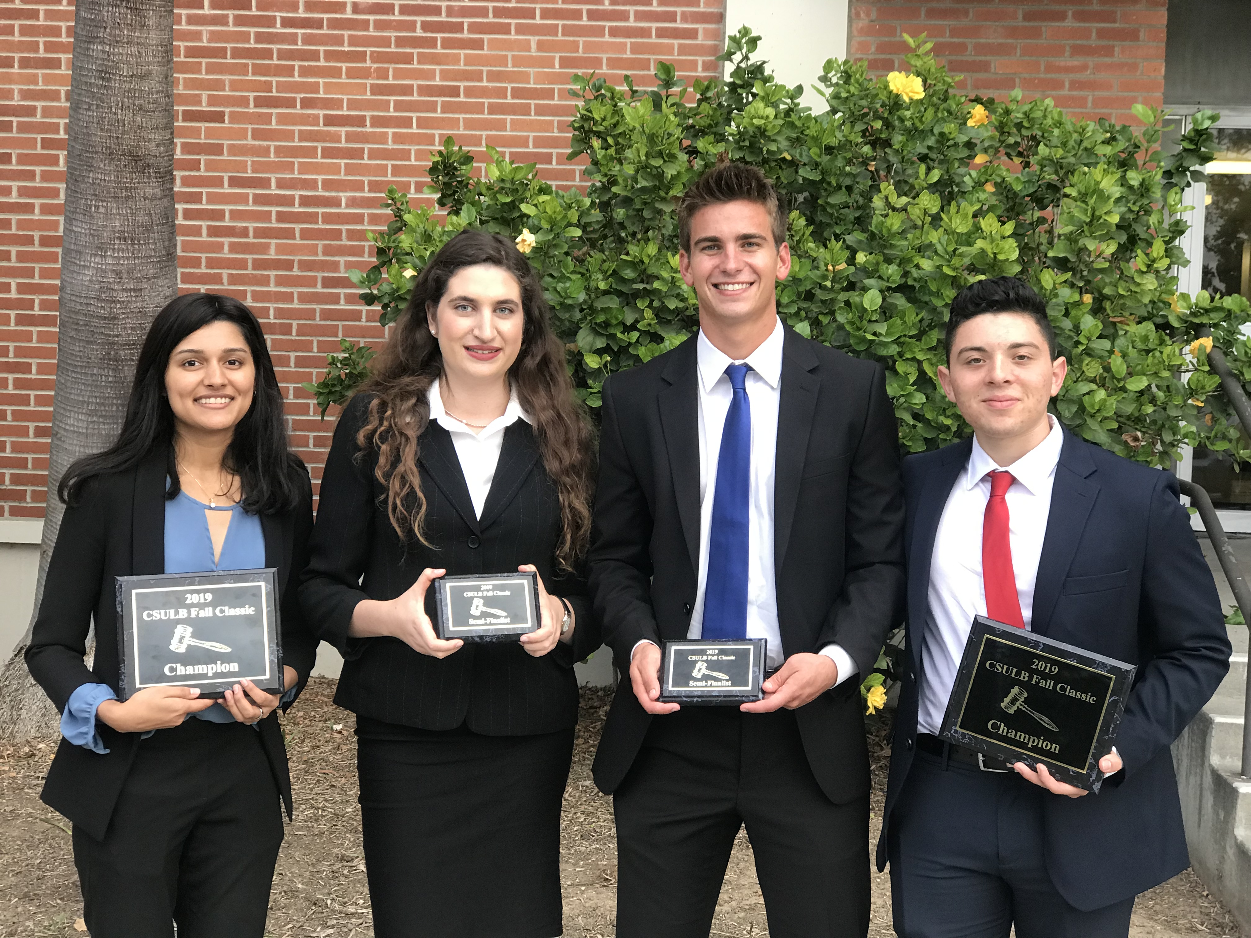 First and fourth place winners at the CA Classic holding awards