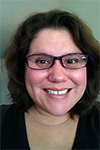 Woman in glasses with short brown hair