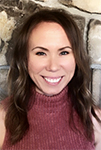 Danielle wearing purple turtle neck with brown hair