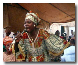 Colorfully dressed woman singing