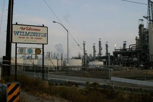 Picture of Welcome to Wilmington sign with oil fields in the background