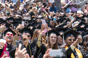 Picture of students taking selfies at commencement
